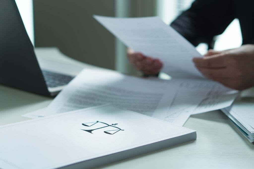 Accountant holding tax document