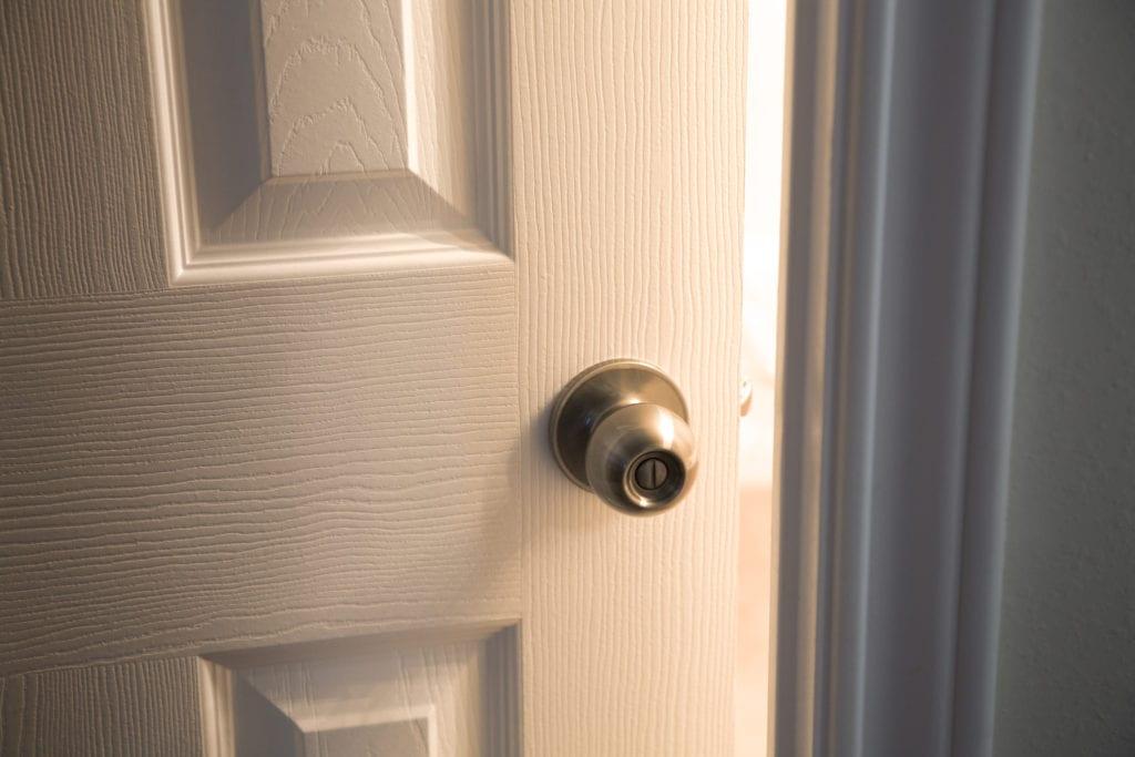 Close up image of open door with handle